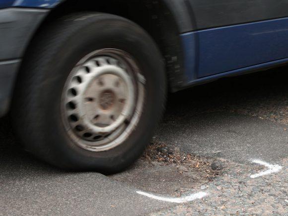 Pothole and car stock image via PA